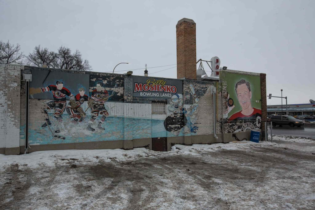 MIKE DEAL / WINNIPEG FREE PRESS The decaying mural on the south side of the Billy Mosienko Bowling Lanes on Main Street. 160218 - Thursday, February 18, 2016